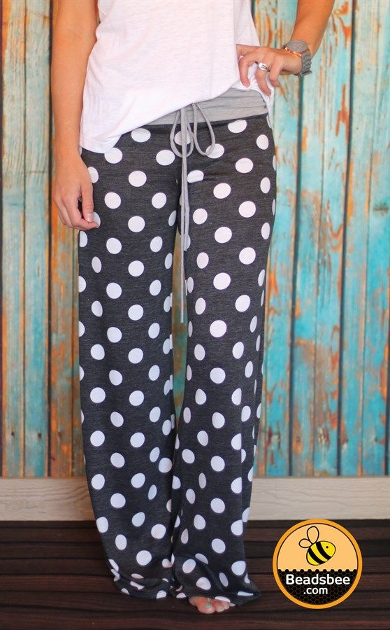 "Cold weather is here and that means sitting by the fire in comfy lounge pants with a good book or movie. We love our new Polka Dot Lounge Pants for lounging around the house or wearing to bed! These feature an AMAZINGLY soft French Terry fabric and come with a high-waisted drawstring band. You will love the extra long length (Inseam is 31"") and the adorable polka dot details to keep you cute and comfy at the same time!Made of 60% Cotton, 35% Polyester, 5% SpandexSmall (0-4)Medium (4-8)Large…"