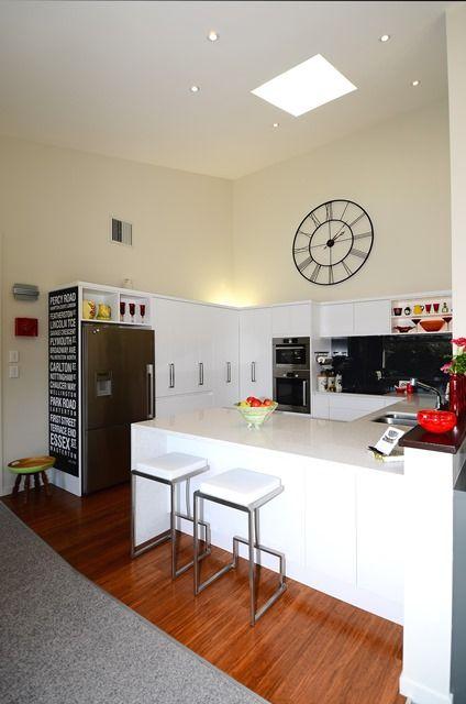 Open-plan kitchen with skylight.