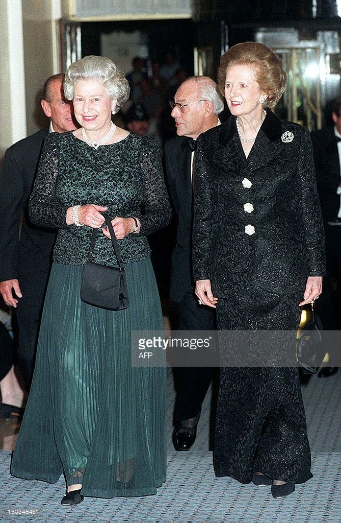 Britain's Queen Elizabeth II (L) and former British Prime Minister Thatcher arrive 16 October 1995 at Claridge's in London for a dinner to celebrate the former Prime Minister's 70th birthday. Baroness Thatcher greeted the Queen warmly, laying to rest past speculation that the two women did not get on with each other.