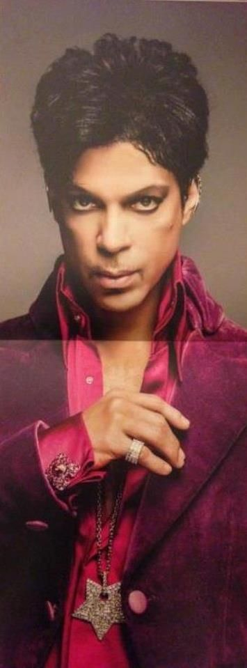 Prince decked in purple - star necklace, diamond pinky ring
