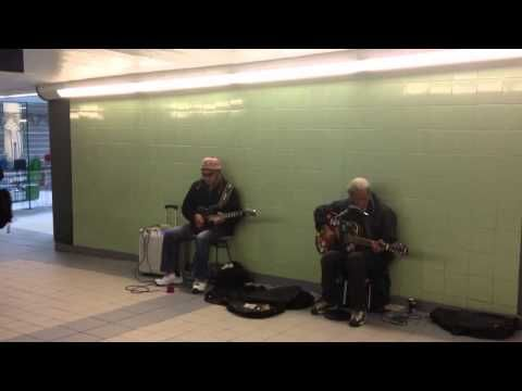 Tom and other busker in train station