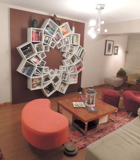 book shelf out of square boxes arranged in a circle. 3 different sizes