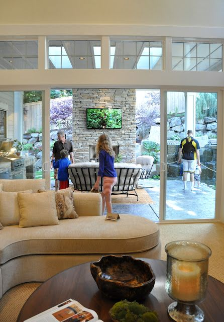 One of the best features of this home, the family room opening up to the outdoor entertaining area...