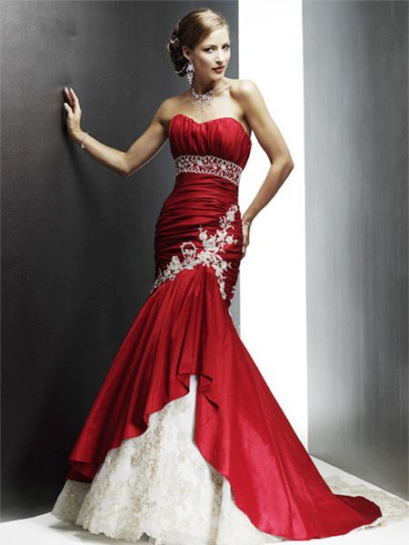 I love this mermaid dress as well! I'm not sure I would be so bold as to wear a red wedding dress though. However I wouldn't mind wearing color (the traditional white gets boring after awhile). Either way, this dress is stunning