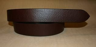 Front view of a brown, soft, handmade leather belt without buckle.