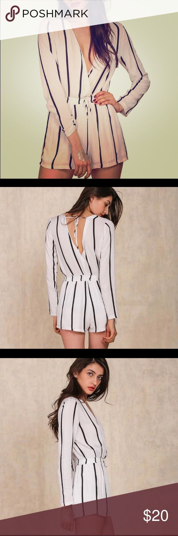NWT white & black stripes long sleeve jumpsuit Up for sale is a brand new white with black stripes jumpsuit/ romper/ playsuit in a size small. Long sleeves with double V. Never worn with tags. Perfect for spring and summer. Pants Jumpsuits & Rompers