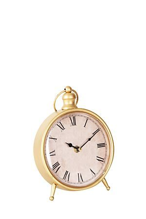 """This gold clock fits perfectly on your bedside table, or looks great on your office table.<div class=""""pdpDescContent""""><BR /><b class=""""pdpDesc"""">Dimensions:</b><BR />L16xH22 cm</div>"""