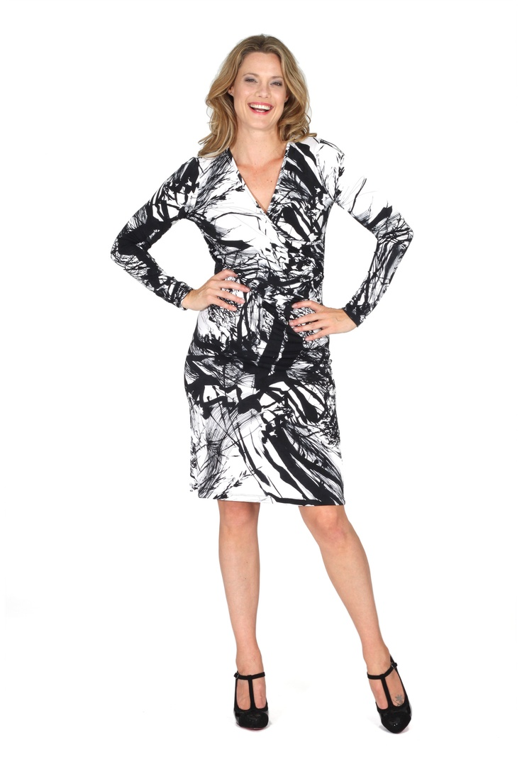 Redhead Office - Tower Knit Dress. This is a striking knit dress in a gorgeous Black and Winter white print. The cross over rouched design is very flattering over all figure types. It's an easy care gorgeous style for all corporate wardrobes.