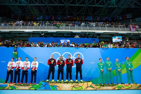 (L-R) Silver medalists Chris Walker-Hebborn, Adam Peaty, James Guy and Duncan Scott of Great Britain, Gold medalists Nathan Adrian, Michael Phelps, Ryan Murphy and Cody Miller of the United States and Bronze medalists Mitchell Larkin, Jake Packard, David Morgan and Kyle Chalmers of Australia pose on the podium during the medal ceremony for the Men's 4 x 100m Medley Relay Final on Day 8 of the Rio 2016 Olympic Games at the Olympic Aquatics Stadium on August 13, 2016 in Rio de Janeiro, Brazil.