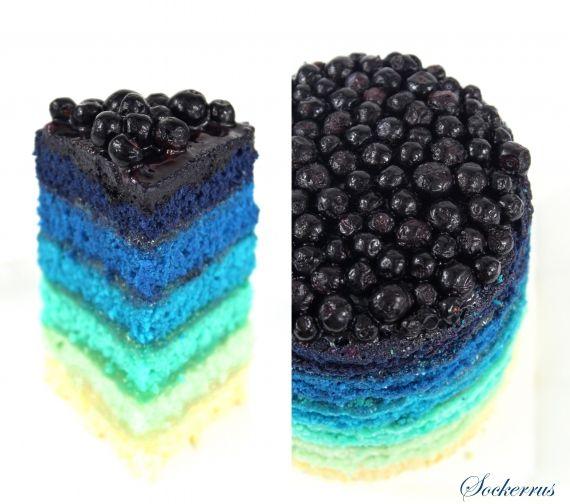 Blue RainbowCake: white velvet cake dyed w/ Wilton paste colors, sky blue & royal blue, filled w/ lemon curd & topped w/ frozen blueberries