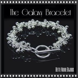 The Galaxy bracelet has become one of Bette Noire's most popular pieces. See why, as silver beads shimmy around your wrist with this weighty piece of .925 silver. It feels substantial and enduring. Wear it every day, since you ARE the center of the universe! $39.