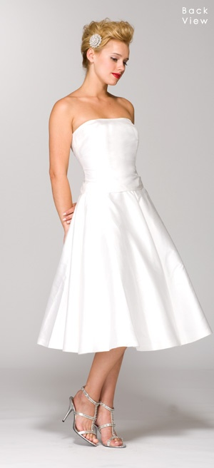 This is what I am looking for my dress to look like. I bought a dress 2nd hand, I am going to hem it to make it tea length, and dye the bow and some other peices of the gown red to add some SPICE! :)