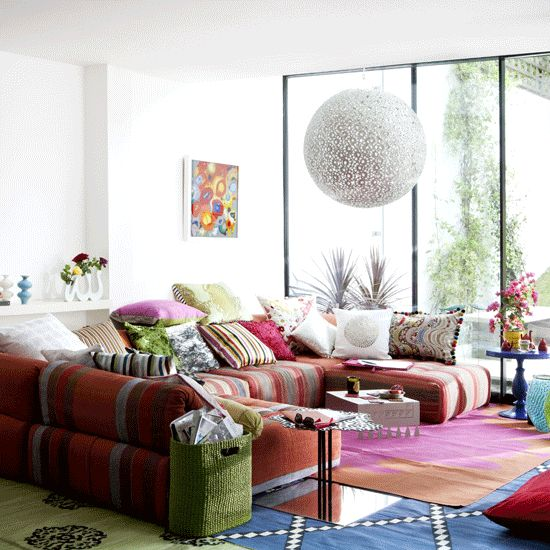 Love the mixture of colour and cushions - looks so comfy!