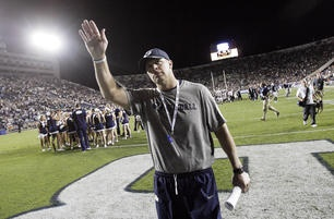 Brigham Young Cougars head coach Bronco Mendenhall waves to the crowd after the UCF game in Provo.