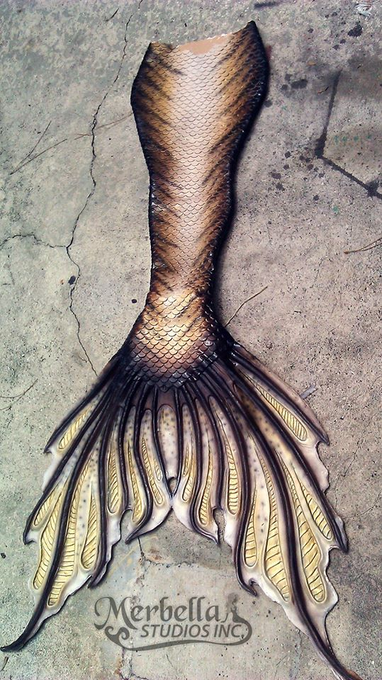 i am absolutely in love with this fluke and silicone mermaid tail design by Merbella studios <3 Not my cup of tea colour-wise but it's still a beautiful mermaid tail <3