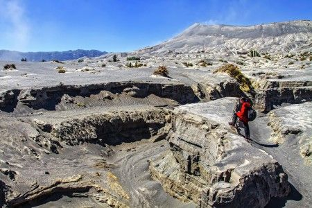 Andry Permadi Widjaja: I saw this Lava track during my visit to Mount. Bromo 2 years ago, a year after Mount. Bromo erupted. I took the picture of My daughter while she was observing the lava track.