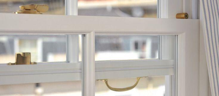 Open timber sash window close up showing sash handle, rola locks and fitch catch. Sash window manufactured and installed by The Sash Window Workshop.