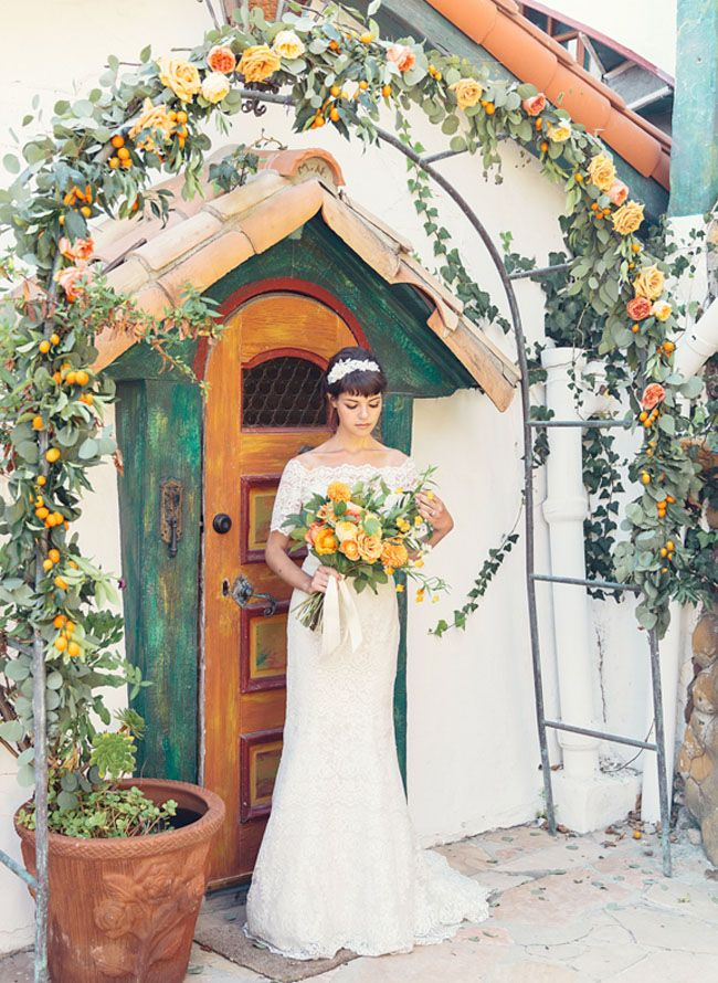 love the colors.  mediterranean flower arch