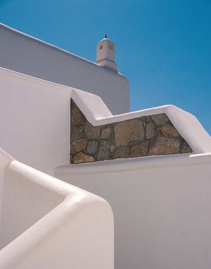 Located on north west part of the resort. The chimney is located above a staircase leading to suites and rooms - Mykonos Grand Hotel & Resort