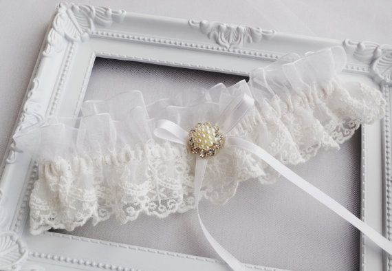 Wedding Garter Ivory Wedding Garter Beaded Chantilly Lace Garter Bride Garters Bow Garter Lace Garter Rhinestone Garter Pearl Garter The lace garter measures approximately 2 high.  Using a tape measure, simply measure around your thigh in the spot where you will be wearing the garter (usually about 4 above your knee). Use that measurement as a guide to select the correct size for your garter. Please measure your thigh carefully to select the correct size. All garters are custom made…