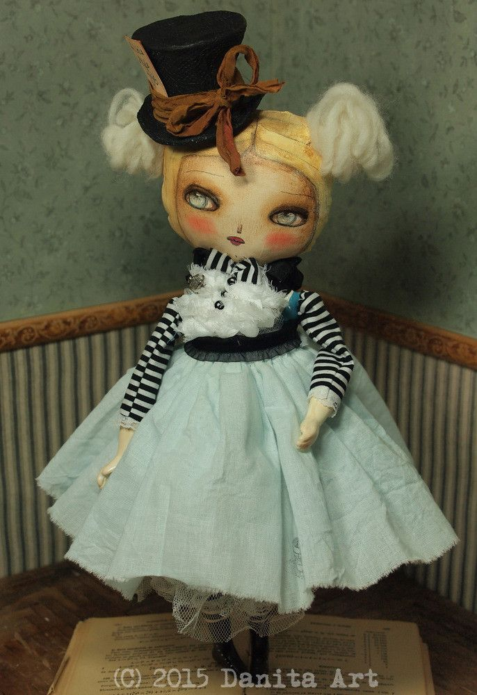 A beautiful original handmade doll by Danita Art, An Alice In Wonderland mashup with the mad hatter.