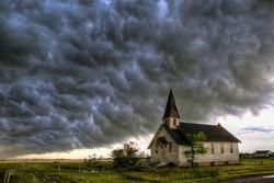 Wartime (The End is Near) - The whales mouth engulfs an old church while stormchasing at Wartime Saskatchewan Canada