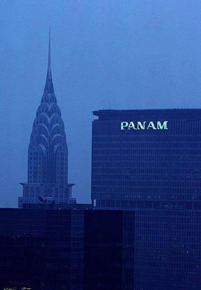 Pan Am Building New York City with the Chrysler Building in the background.  My first and only helicopter ride landed on the top of the Pan Am building in the 60s.  Built in 1963, MetLife acquired the building in 1981.