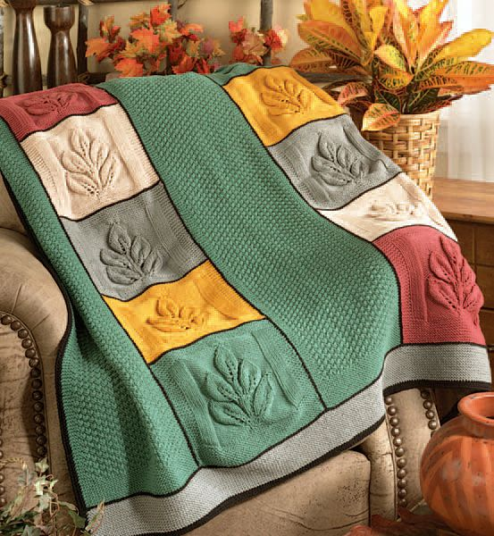 Free Knitting Pattern for Shoots and Ladders Afghan - This award-winning afghan knitting pattern designed by Susan Kerin is knit in strips of leaf motifs and seed stitch. Winner in Herrschners Knit Afghans 2006 National Afghan Contest