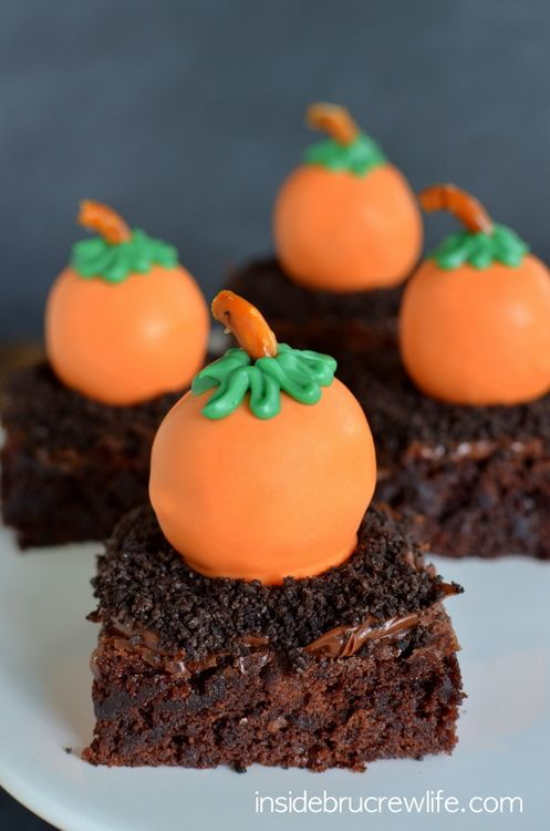 Peanut butter truffles dipped in orange candy melts to look like pumpkins