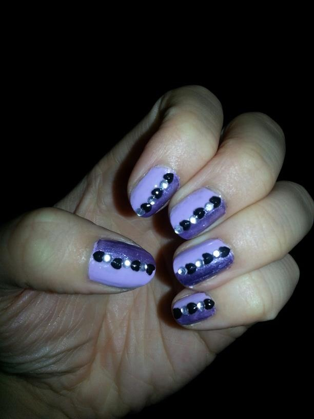 Two-toned purple nails with black heart and rhinestone accent.  https://www.facebook.com/TrendyNailsByAmanda