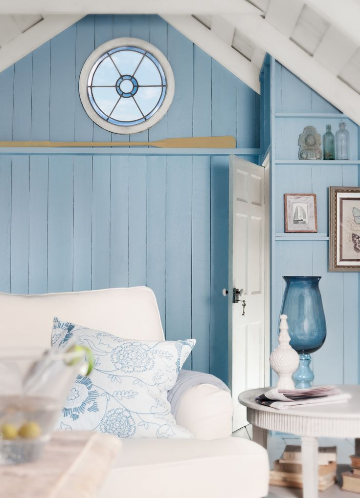 The oar & great stained glass window against the ocean blue wall give such a casual beachy feel....