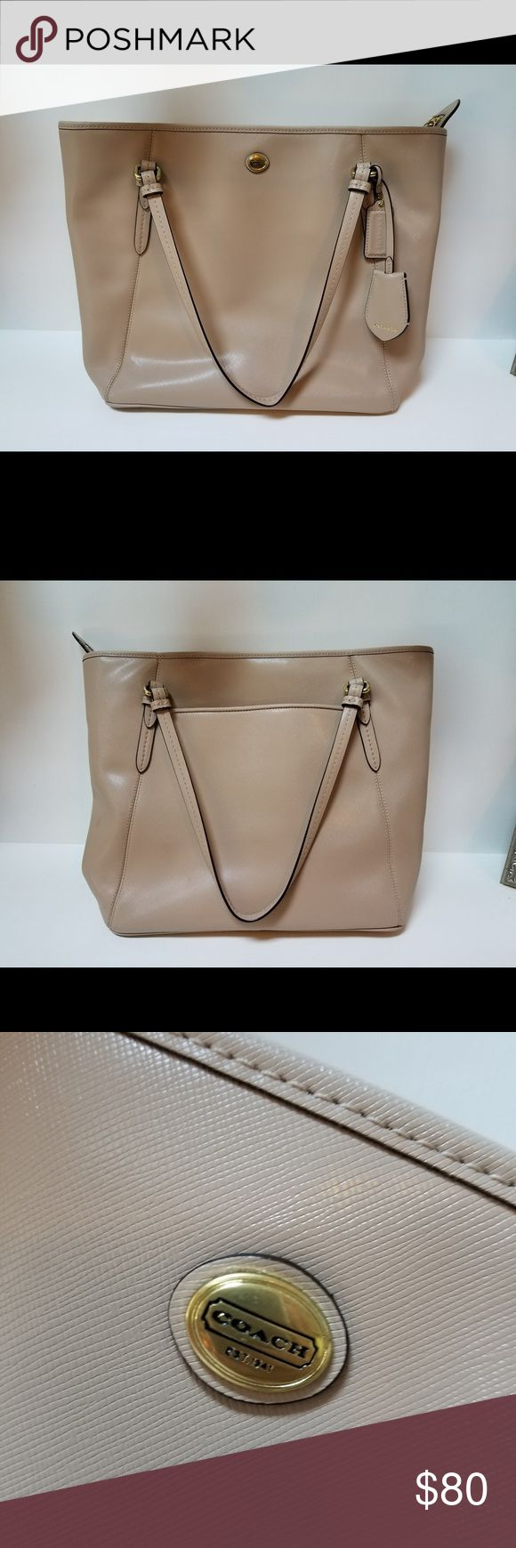 Coach tote bag Coach tote bag. Gently used and in great condition minus two small stains on the inside of the pocket on the outside, but not visible to the outside world. Plenty of room and pouches for storage. Coach Bags Totes