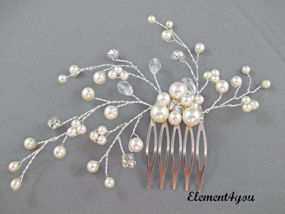 Hey, I found this really awesome Etsy listing at http://www.etsy.com/listing/114216935/bridal-comb-ivory-pearls-hair-piece