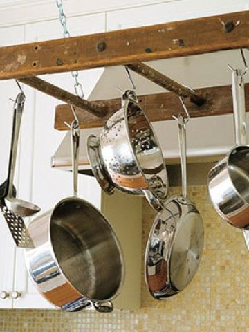 When suspended from the ceiling, this vintage ladder becomes a wonderful pan rack.
