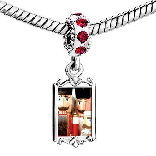 Pugster Ruby Red Swarovski Crystal Dangle Christmas Nutcrackers Photo Bead Silver Plated Bead Fits Pandora Charms Bracelet Pugster. $22.99. Fit Pandora, Biagi, and Chamilia Charms beads. Ruby Red Swarovski Crystal Charm Bead design. Pugster are adding new designs all the time. Unthreaded European story bracelet design. Dangle Charm design