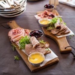cold Christmas platter with gammon & beef with a sweet mustard sauce and cranberry preserve.