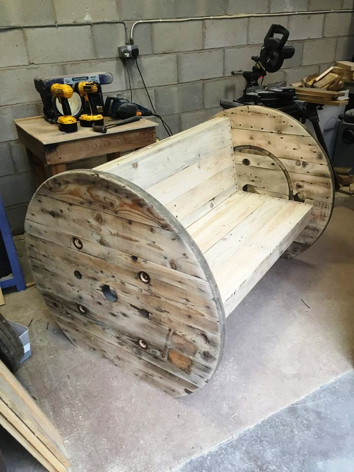 recycled pallet bench with spool wheel legs and sides                                                                                                                                                                                 More