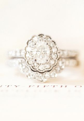 Unique engagement ring -Oval-cut diamond engagement ring with halo setting {Katelyn James Photography}
