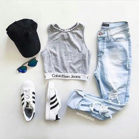 grey calvin klein crop top with distressed light wash jeans and adidas three stripe tennis shoes and black baseball cap