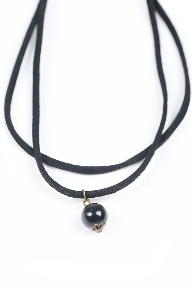 The necklace featuring bead pendent. Double-layered chain.