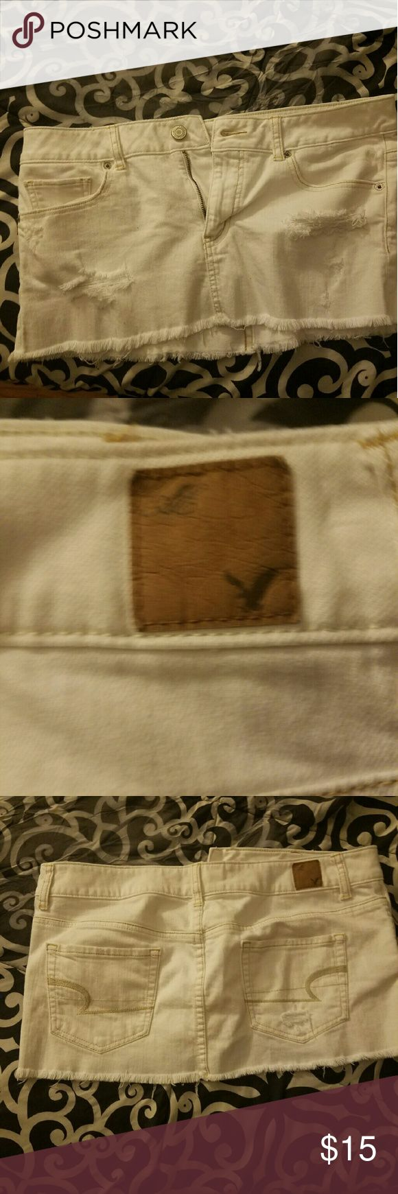 """American Eagle white denim Destroyed white denim skirt from American Eagle measures from top to bottom 11"""". American Eagle Outfitters Skirts Mini"""