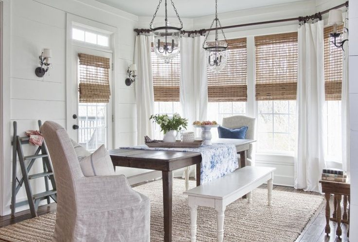 bay window/window treatments panels with bamboo Roman shades
