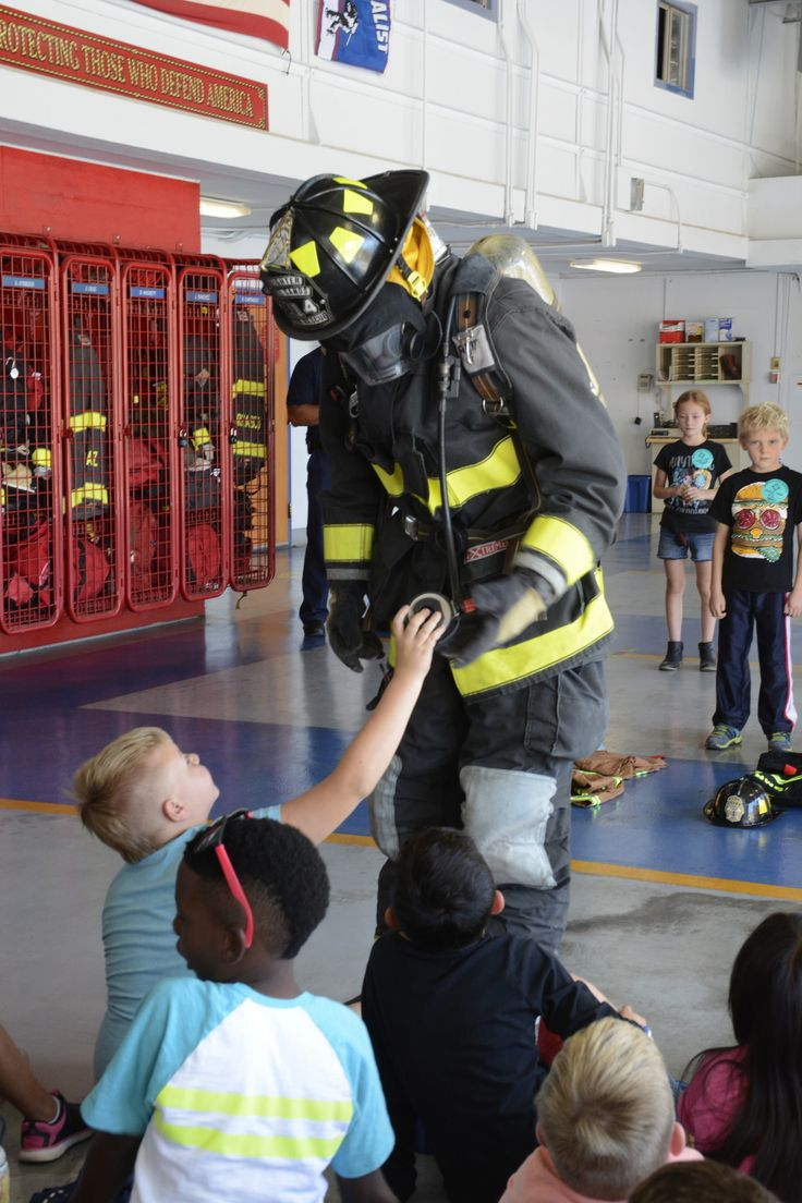 https://flic.kr/p/NajHes   WSMR Firefighter   Photo by Adriana Salas de Santiago  A WSMR Firefighter shows White Sands Elementary School students the components of his uniform after he demonstrated how fast firefighters must put on their uniforms during emergencies Oct. 12. The students were then asked to compete against each other to see who could put on their firefighter costume faster.