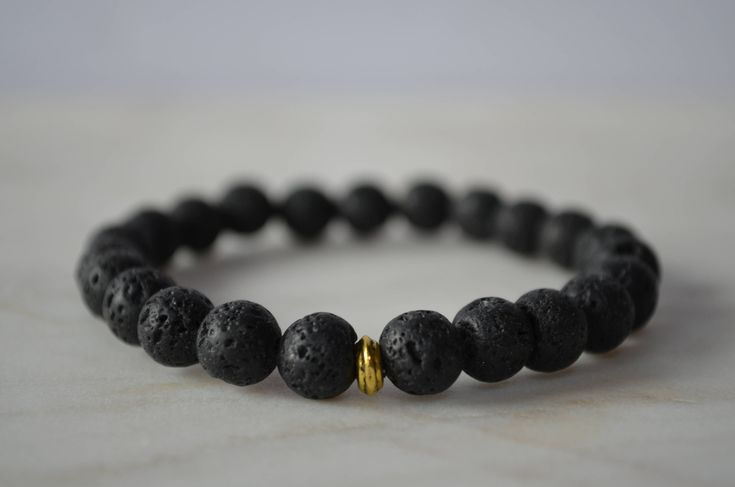 Excited to share the latest addition to my #etsy shop: Black Volcanic Lava Stone Bracelet. Stretch Bracelet. Protective Bracelet. Grounding Bracelet. Essential Oil Diffusing Bracelet.