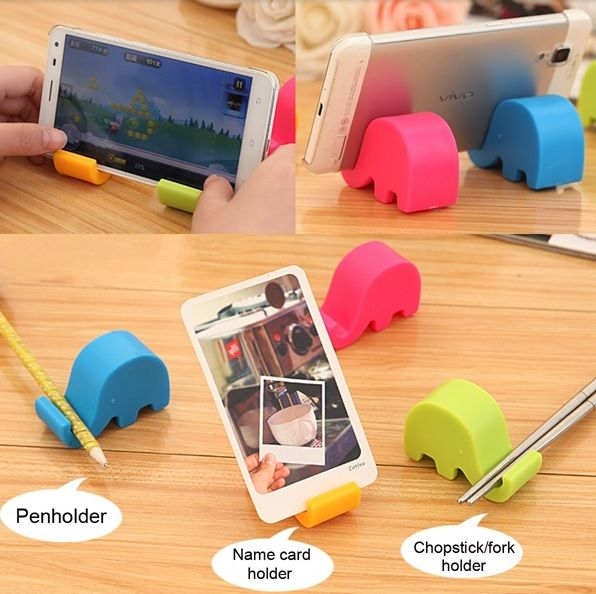 Mini Elephant Cell Phone Holder . The cute designed mini elephant provides steady and firm support, it can hold your cell phone horizontally or vertically as you needed.