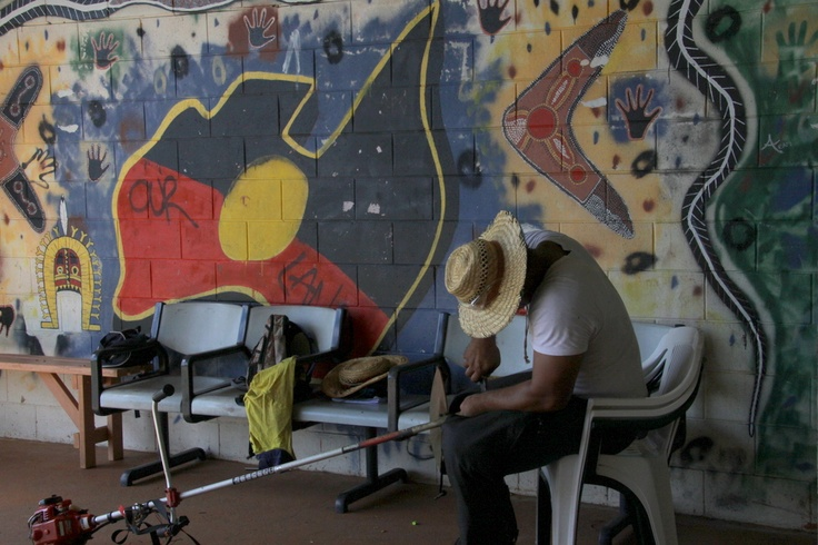 My Indigenous Australia shot - love the background and the worker in the foreground mending his whipper snipper