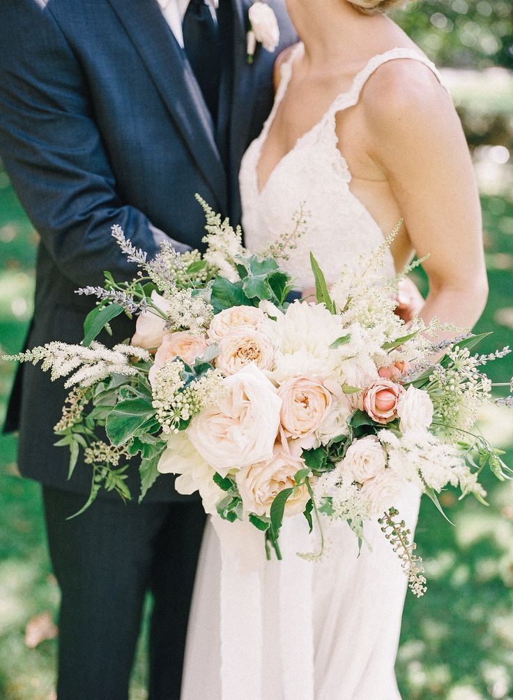 Bride's bouquet with White O'Hara, Keira and Eden Romantica Garden Roses. Accented with Geranium, Polk Weed, Jasmine, Viburnum, Astilbe and Lavender.