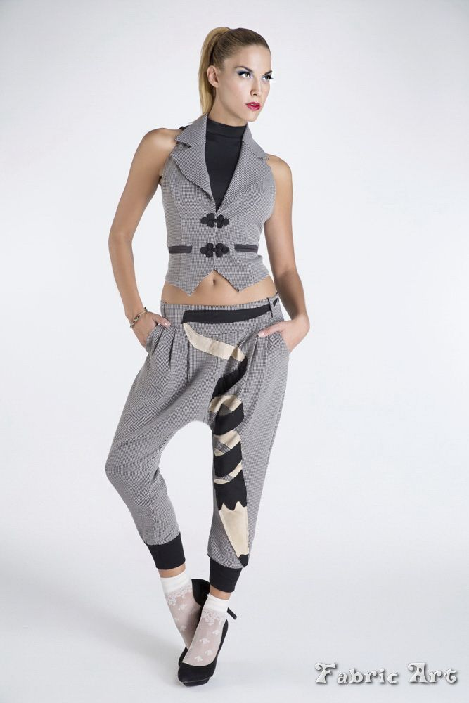 """Lapel gilet with tie back detail and woven trousers with pleats and handmade applique """"Creative pencil""""."""