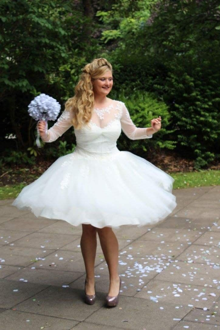 a5ea7a85fe76b David's Bridal bride Jessica in a short long sleeve wedding dress by Truly  Zac Posen available