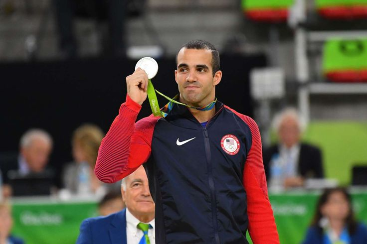 Danell Leyva of the United States celebrates after winning a silver medal in the men's parallel bars final in the Rio 2016 Summer Olympic Games at Rio Olympic Arena.     -   Rio Olympics: Best images from Tuesday, Aug. 16